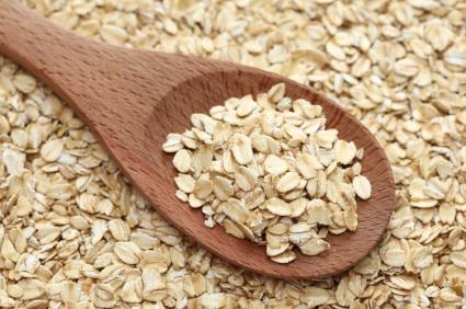 Rolled oats in a wooden spoon
